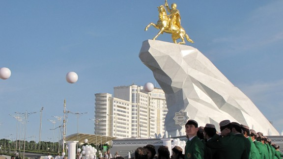 Young Turkmen men and women take part in an opening ceremony of the first monument to Turkmenistan's current president Gurbanguly Berdymukhamedov in Ashgabat