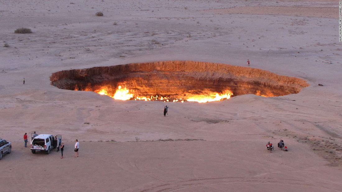 "Welcome to ""The Gateway to Hell.""  This huge burning gas crater in the heart of Turkmenistan's Karakum desert was the result of a simple miscalculation by Soviet scientists in 1971. After their boring equipment drilled into an underground cavern, a deep sinkhole formed. The scientists took the decision to set the pit alight, thinking that the gas would burn out quickly but it never has."