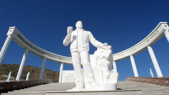 As well as burning gas craters, Turkmenistan has statues -- lots of them. This one is of Turkmenistan's former President Saparmurat Niyazov in front of the earthquake memorial in Ashgabat.