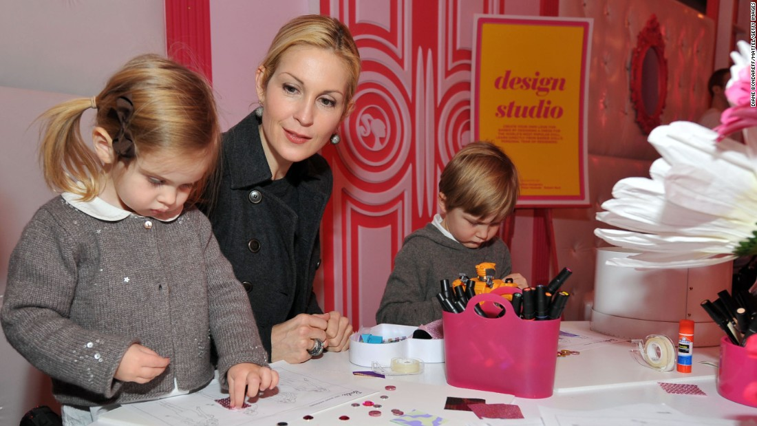 Actress Kelly Rutherford and her two children, Helena and Hermes, create designs at a New York Fashion Week event in 2012.