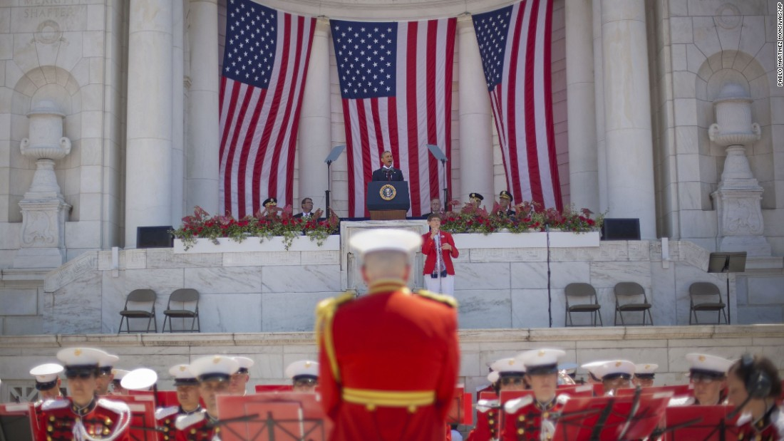 "President Barack Obama speaks at Arlington National Cemetery on May 25. Playing just below Obama are members of ""The President's Own"" United States Marine Band."
