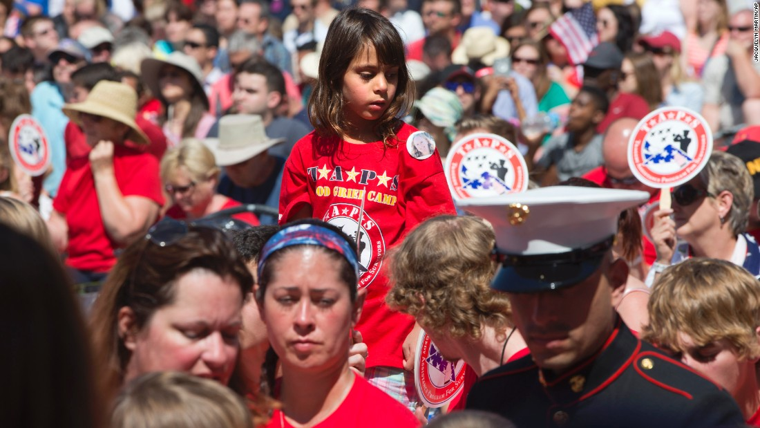Amyra Alkhafaji, 6, attends a Memorial Day ceremony at Arlington National Cemetery on May 25. She is wearing a button of her cousin Karissa Ulmer, who died last year while serving in the National Guard.