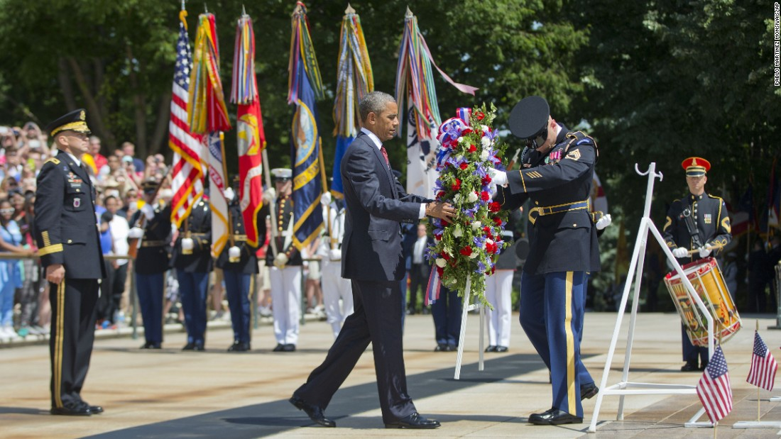 Obama attends a wreath-laying ceremony at the Tomb of the Unknowns in Arlington on May 25.