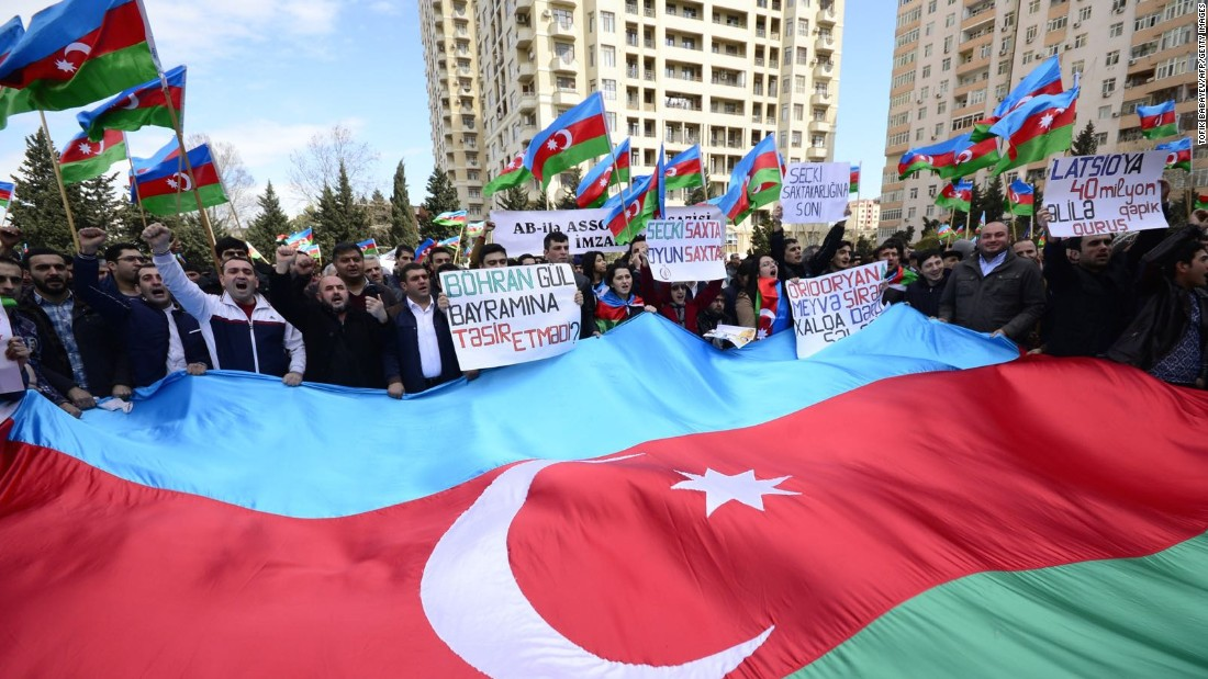 "One Azeri journalist told us you have to be a ""maniac"" to openly demonstrate in Azerbaijan -- yet protests do take place. These opposition supporters campaigned on the streets in April 2015."