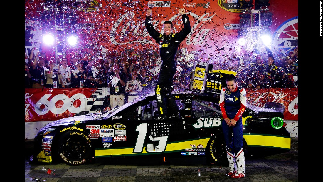 NASCAR driver Carl Edwards celebrates on his car Sunday, May 24, after winning the Coca-Cola 600 in Charlotte, North Carolina.
