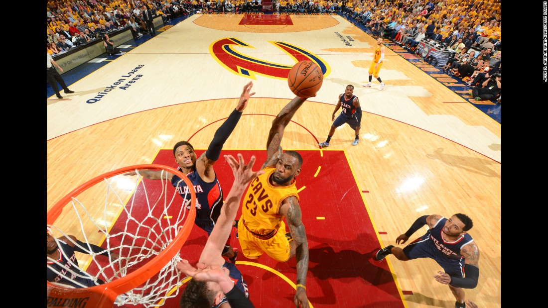 Cleveland's LeBron James throws down a dunk during the NBA's Eastern Conference Finals on Sunday, May 24. James had a triple-double -- 37 points, 18 rebounds and 13 assists -- to help the Cavaliers take a 3-0 series lead on the Atlanta Hawks.