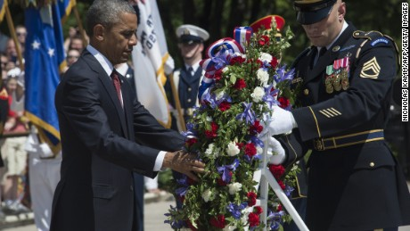 President Barack Obama lays a wreath at the Tomb of the Unknowns on Memorial Day 2015 at Arlington National Cemetery.