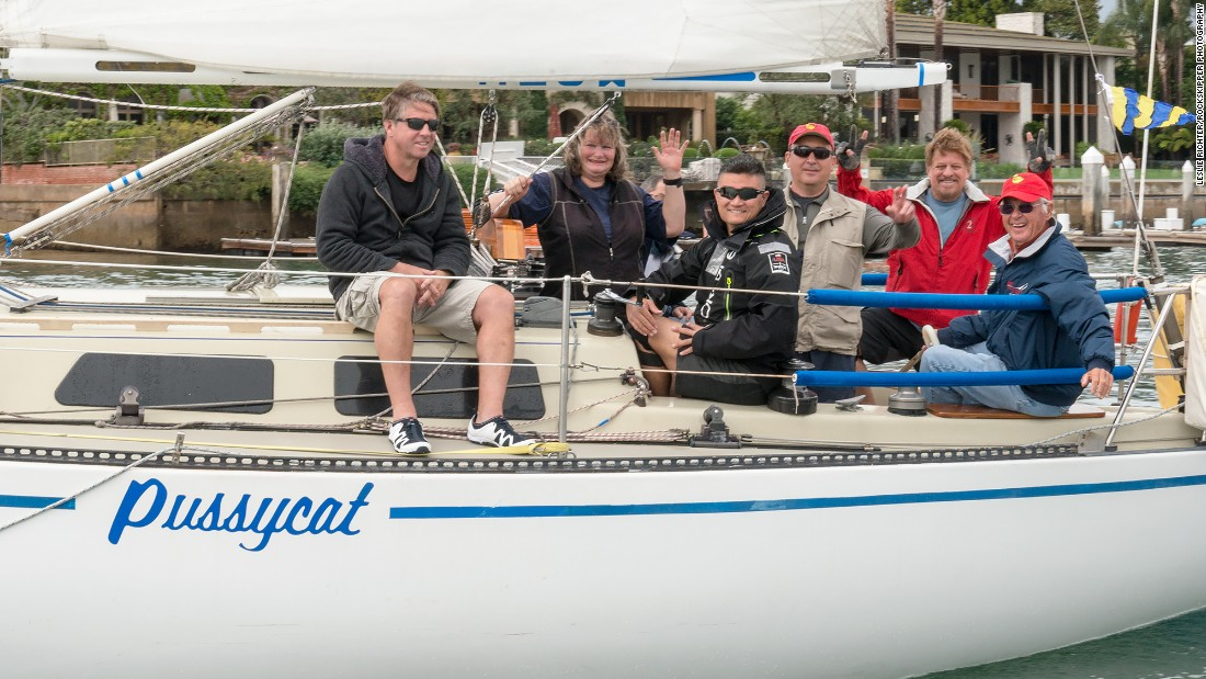 John Szalay and his crew aboard the skipper's 34-foot-long Peterson sloop.