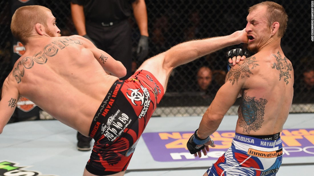 Justin Scoggins kicks Joshua Sampo during their flyweight bout at UFC 187 on Saturday, May 23. Scoggins won by unanimous decision.