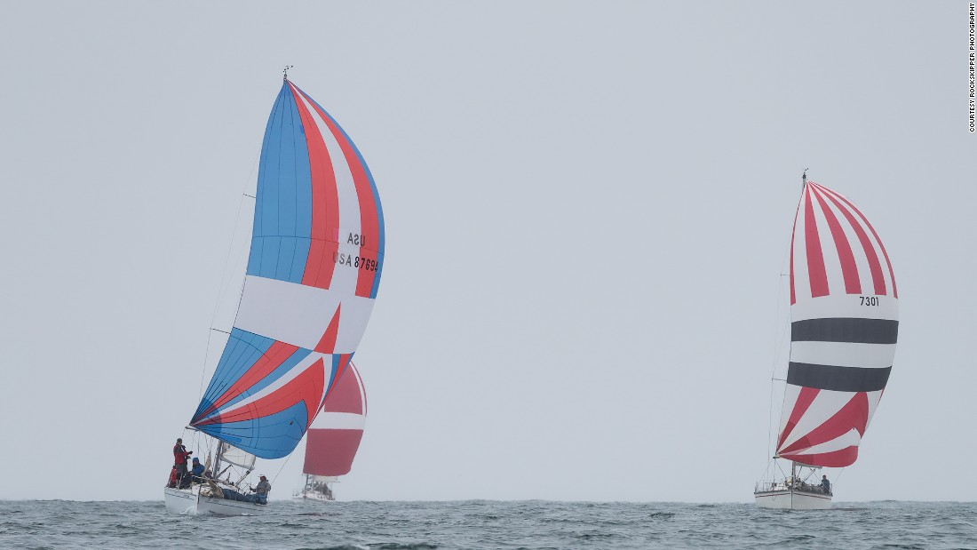 This year's Newport to Ensenada International Yacht Race was marked by rogue showers -- but not enough to reign in the spinnakers of these racing sailboats.