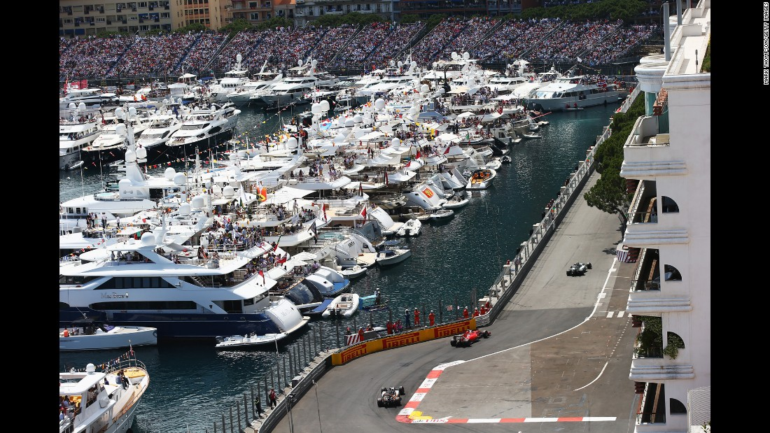 Spectators watch the Monaco Grand Prix from boats and grandstands during the Formula One race on Sunday, May 24.