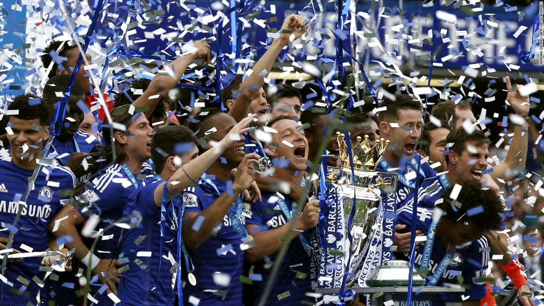 Chelsea captain John Terry holds the Premier League trophy as he and his teammates celebrate their title-winning season Sunday, May 24, in London. The soccer club actually clinched the title on May 3.