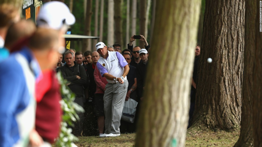 Lee Westwood plays a shot from the trees during the second round of the BMW PGA Championship on Friday, May 22. The European Tour event was held in Virginia Water, England.