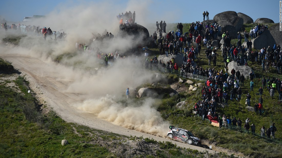 The car of Mads Ostberg and Jonas Andersson races down a hill in Porto, Portugal, on Saturday, May 23, during the second day of a World Rally Championship event.
