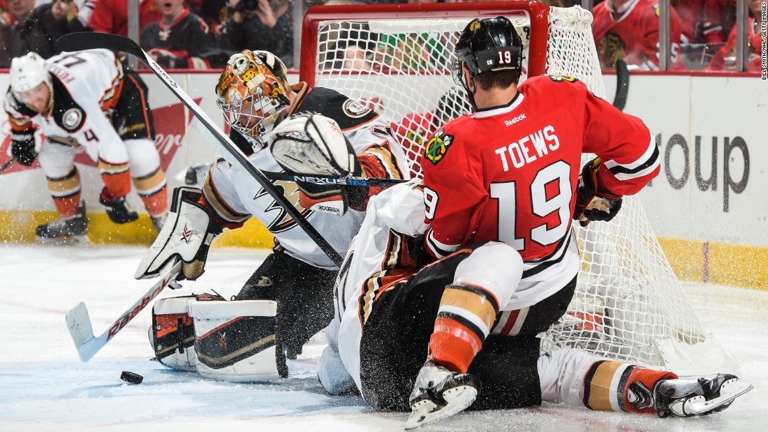 Chicago captain Jonathan Toews falls on top of Anaheim's Ryan Kesler, next to Anaheim goalie Frederik Andersen, during Game 4 of the NHL's Western Conference Finals on Saturday, May 23. Chicago won in double overtime to even the series at 2-2.