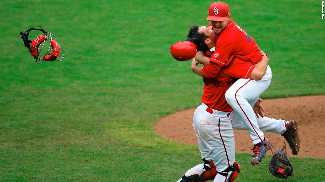 St. John's catcher Tyler Sanchez, left, hugs pitcher Ryan McCormick after they defeated Creighton to win the Big East baseball tournament on Sunday, May 24.