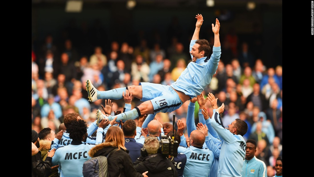 Frank Lampard is thrown into the air by his Manchester City teammates after their final match of the season Sunday, May 24, in Manchester, England. Lampard is leaving the club to play in the United States.