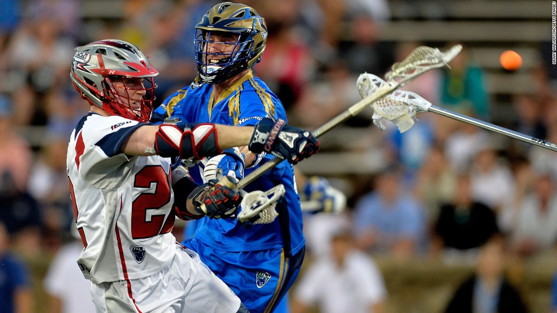 Sean Meagher of the Charlotte Hounds defends a shot by Craig Bunker of the Boston Cannons during their Major League Lacrosse game in Charlotte, North Carolina, on Saturday, May 23.