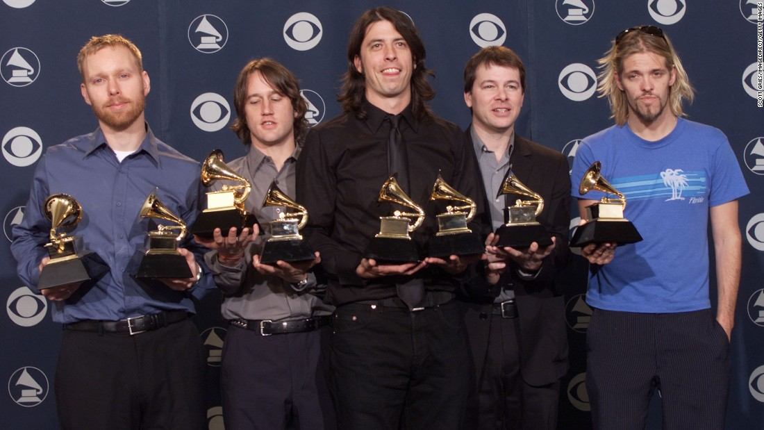 The Foo Fighters pose backstage with their Grammys at the 2001 ceremony.