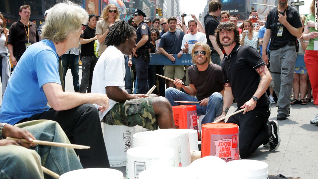 "Stewart Copeland of The Police, Taylor Hawkins of the Foo Fighters and Grohl perform in a drum circle during MTV2's ""24 Hours Of Foo"" at New York's Times Square in 2005."