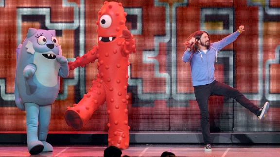 "Grohl performs with members of ""Yo Gabba Gabba!"" a children"
