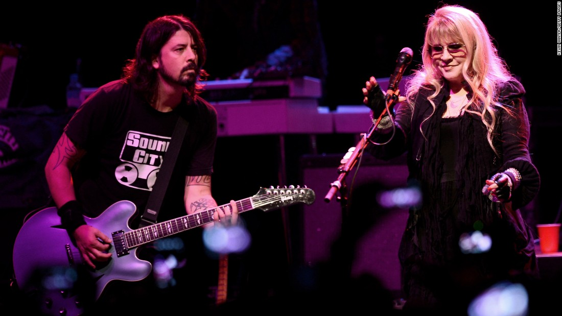 "Grohl and Stevie Nicks perform at a concert to celebrate the premiere of his film ""Sound City"" in 2013 in Los Angeles."
