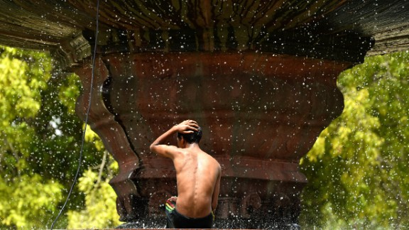 A fountain in New Delhi spells relief from the heat on May 26. Two-thirds of India