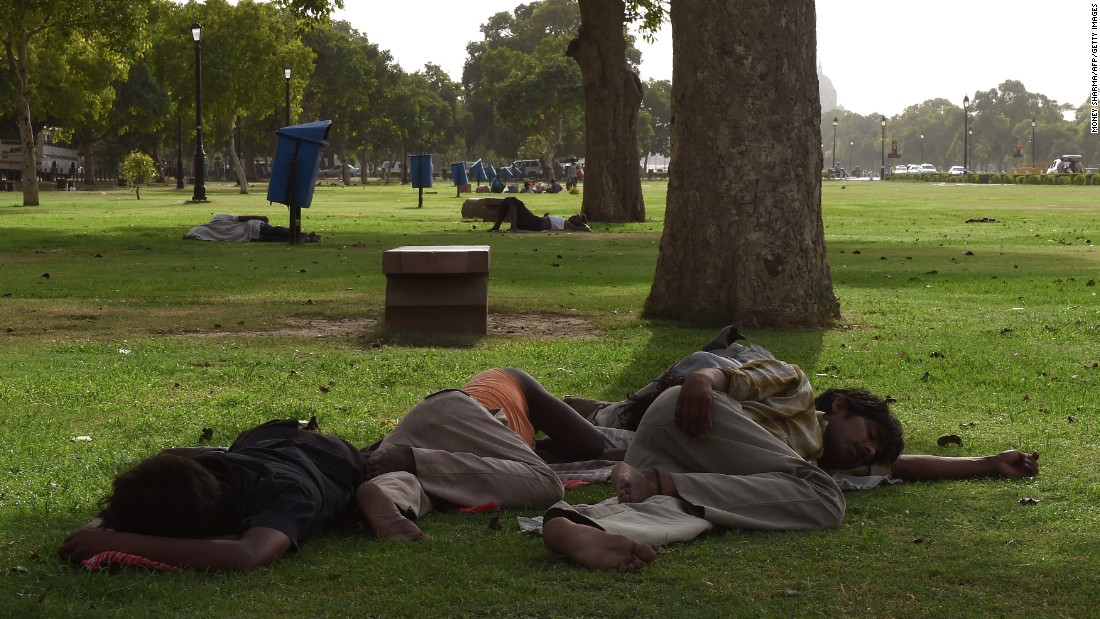 People in New Delhi rest in the shade on May 26.