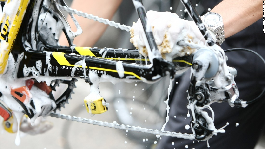 An Astana mechanic cleans the chain of a bicycle before a training session on one of the two rest days of the 2009 Tour de France.
