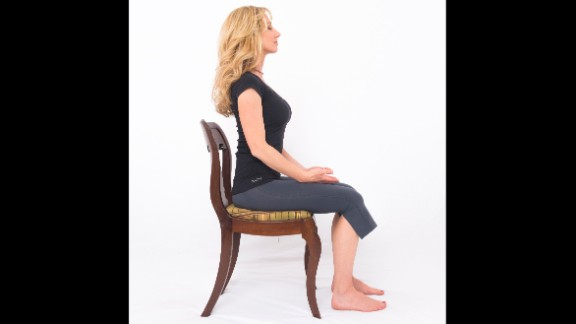 Sit comfortably with both feet on the floor. Establish good posture by exhaling as you drop your ribcage down in front and your shoulder blades down in back. Rest your hands on the tops of your legs with your palms up. Close your eyes. Relax your jaw, resting your lips in a slight smile. Take conscious control of your breathing, emphasizing your first few exhales, like sighs of relief. Tune out distractions, focusing all of your attention on expanding your lower ribs on inhalation and contracting them on exhalation. Try breathing long and deep at the following pace: 5-count inhale, 7-count exhale. Once you've established a comfortable breathing rhythm, count your breaths backwards from ten to one. Open your eyes and notice your profound change in perspective.