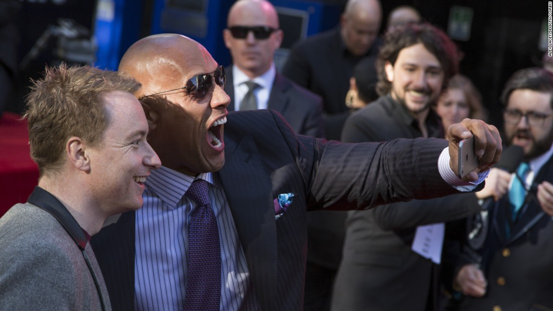 "Actor Dwayne Johnson snaps a photo with a fan in London at the premiere of his new film ""San Andreas"" on Thursday, May 21. Johnson <a href=""http://www.techtimes.com/articles/55295/20150526/dwayne-the-rock-johnson-sets-guinness-world-record-for-most-selfies.htm"" target=""_blank"">set a new Guinness World Record</a> by taking 105 selfies in three minutes."