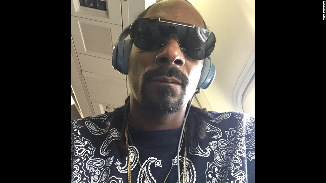 "Rapper Snoop Dogg is flying back to Los Angeles in this selfie <a href=""https://instagram.com/p/3JSdpdv9CG/"" target=""_blank"">he posted to Instagram</a> on Tuesday, May 26. He said it came after an eight-day, nonstop album release push. ""Thanks to my team n my family for holding me down,"" he wrote."