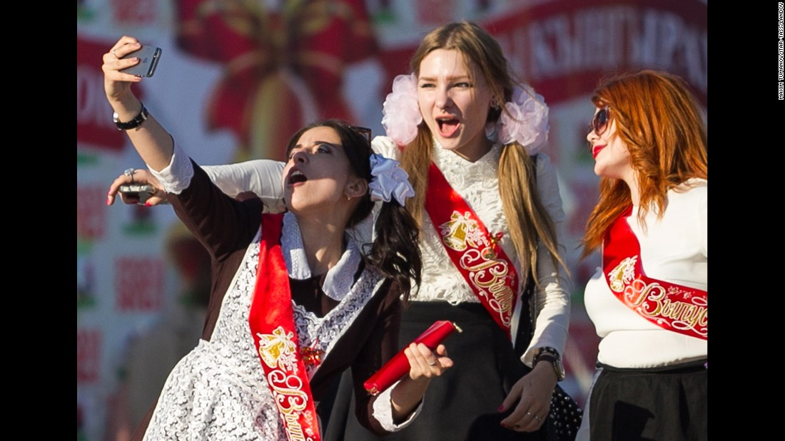 Young women in Kazan, Russia, take a selfie Friday, May 22, as they celebrate the end of classes before final exams.
