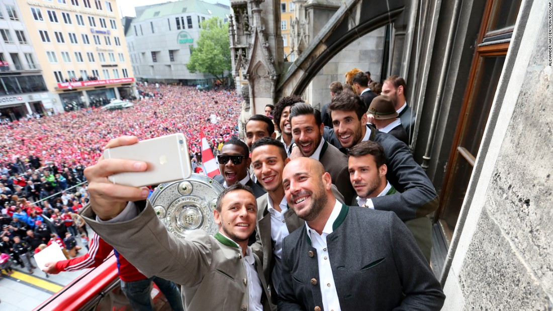 Soccer player Rafinha takes a selfie with his Bayern Munich teammates as they celebrate their German league title in Munich on Sunday, May 24.