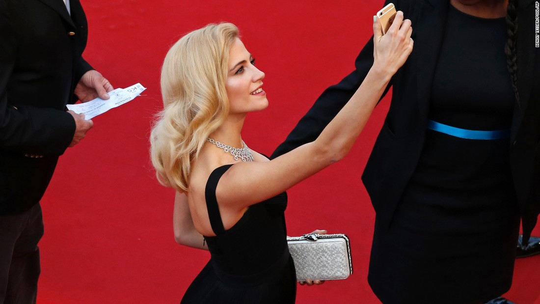 Singer Pixie Lott snaps a selfie as she arrives for a screening at the Cannes Film Festival on Thursday, May 21.