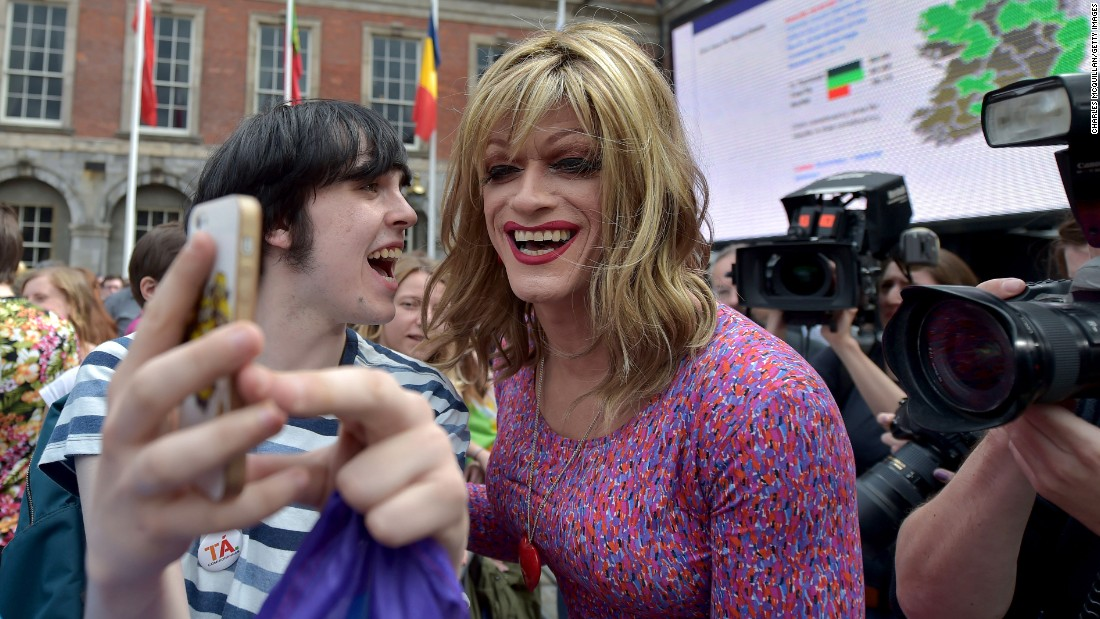 "Activist and drag queen artist Panti Bliss, right, takes a selfie with a supporter on Saturday, May 23, as thousands gathered in Dublin, Ireland, to await the outcome of a referendum on same-sex marriage. Voters in Ireland <a href=""http://www.cnn.com/2015/05/23/europe/ireland-referendum-same-sex-marriage/"" target=""_blank"">overwhelmingly chose to change their nation's constitution,</a> becoming the first country in the world to legalize same-sex marriage through popular vote. <a href=""http://www.cnn.com/2015/05/20/living/gallery/selfies-look-at-me-0520/index.html"" target=""_blank"">See 28 selfies from last week</a>"