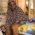 maiduguri -- woman with child on bed
