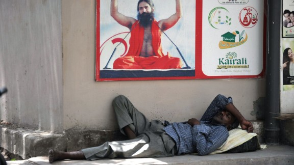 An Indian man rests in the shade on a hot summer day in Hyderabad on May 26, 2015. More than 430 people have died in two Indian states from a days-long heatwave that has seen temperatures nudging 50 degrees Celsius (122 degrees Fahrenheit), officials said May 25.