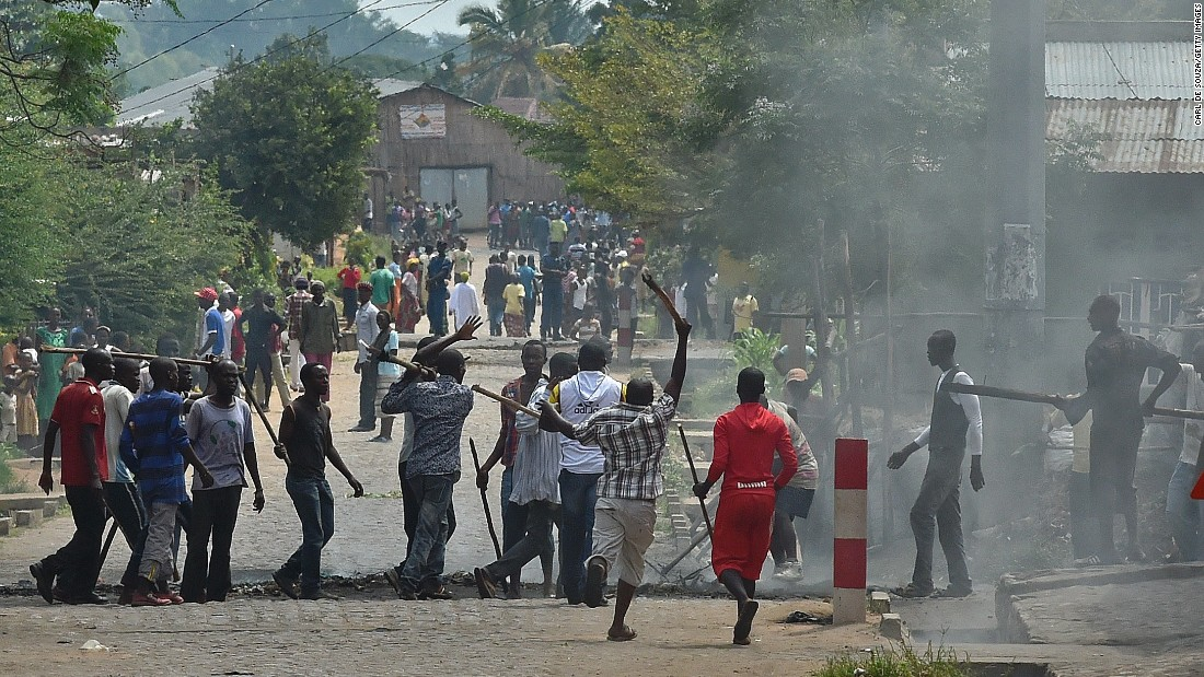Armed with sticks, members of the Imbonerakure, the youth wing of the ruling party, grab a protester Monday, May 25, in Bujumbura.