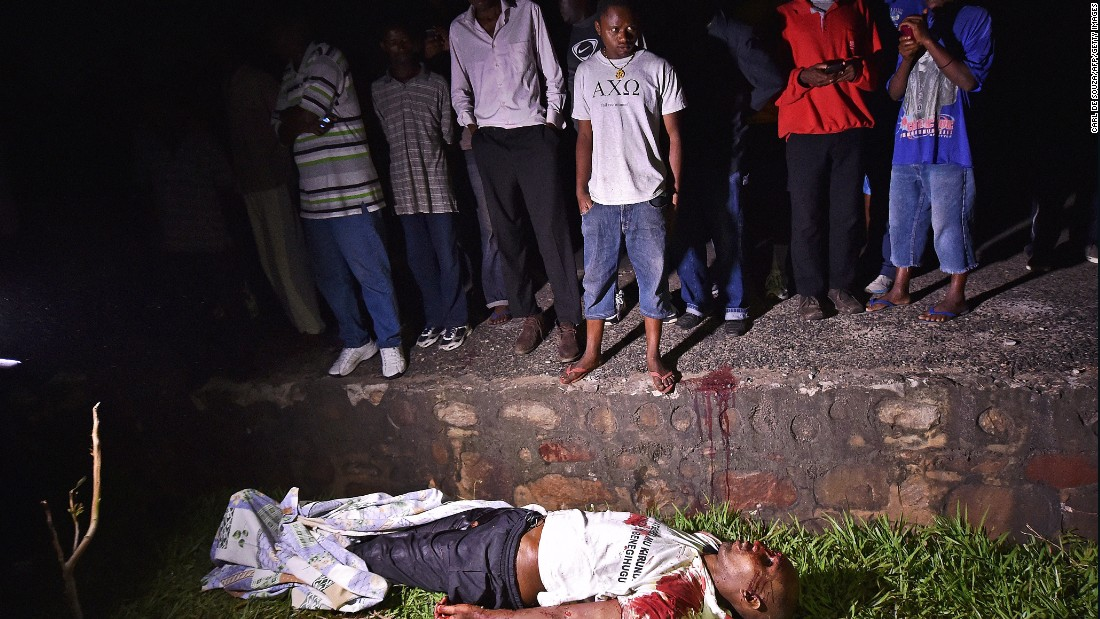 "The body of Zedi Feruzi, a political opposition leader, lies on a road near his home in Bujumbura's Ngagara district on Saturday, May 23. He was <a href=""http://edition.cnn.com/2015/05/23/africa/burundi-unrest/index.html"" target=""_blank"">killed in a drive-by shooting.</a>"