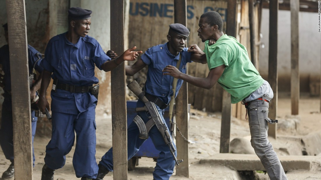Police detain a protester at an anti-government demonstration in Bujumbura on May 26.