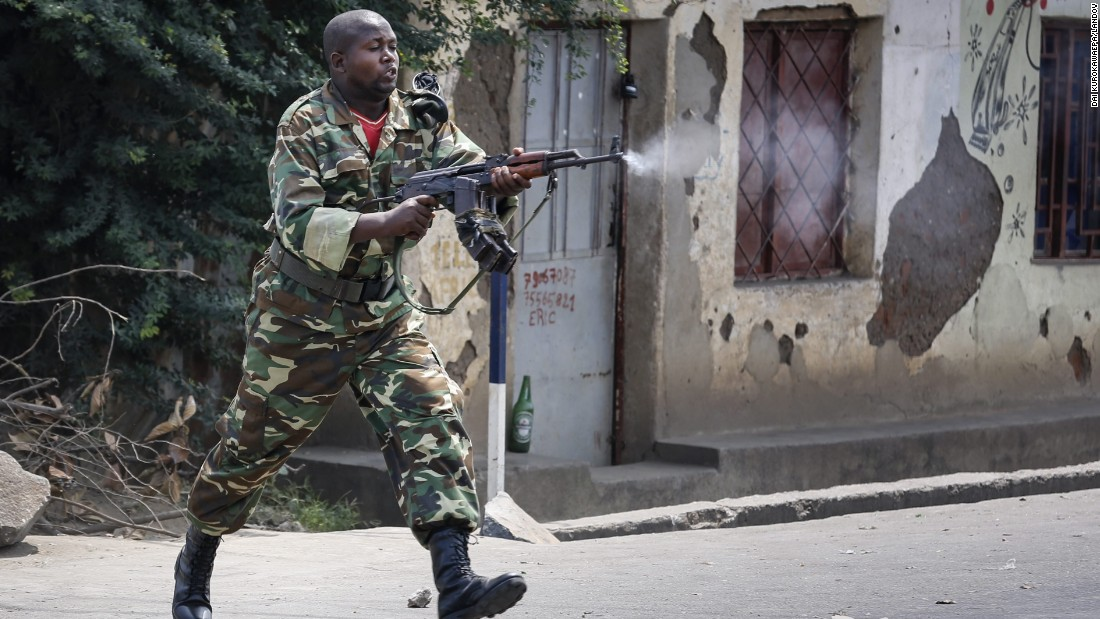 A Burundian soldier fires a shot toward protesters at an anti-government demonstration in Bujumbura on May 25.