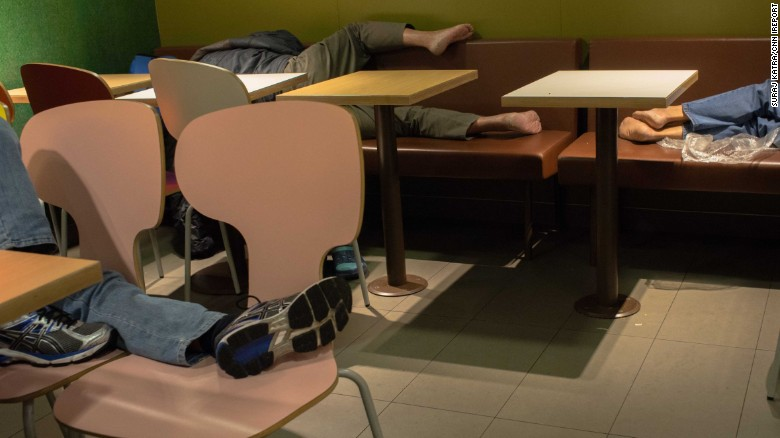 People sleep at a McDonald's in 2015.