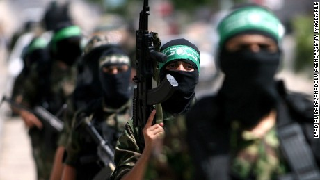 Members of Hamas' military wing, Izzedine al Qassam, parade in southern Gaza in May 2014.