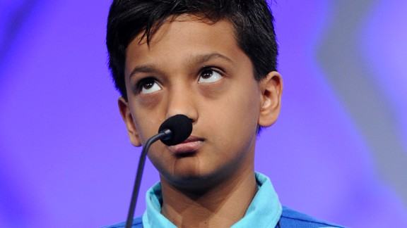 "Jairam Hathwar, 12, of Corning, New York, spells the word ""harpsichord."" Spelling bees can be a prestige activty for Indian parents."