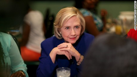 Democratic Presidential Candidate Hillary Clinton sits in on a round table discussion as she visits the Kikis Chicken and Waffles restaurant on May 27, 2015 in Columbia, South Carolina.