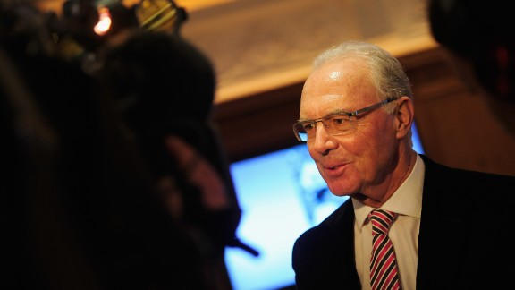 German footballer Franz Beckenbauer, the only man to win the World Cup as captain and coach, is provisionally suspended from any football-related activity for 90 days for failing to cooperate with a FIFA corruption investigation. FIFA says Beckenbauer had been asked to help with its Ethics Committee