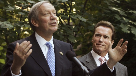 Pataki, left, and then-California Governor Arnold Schwarzenegger speak to the media in the courtyard of the Solaire Building, the largest residential green building in the nation, October 16, 2006 in New York City.