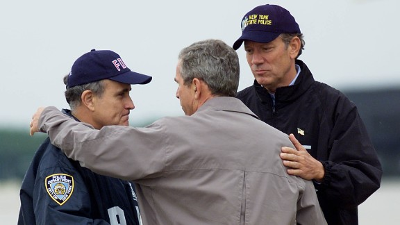 Then-U.S. President George W. Bush, center, greets then-New York City Mayor Rudy Giuliani, left, and then-New York Governor George Pataki September 14, 2001 in New York.