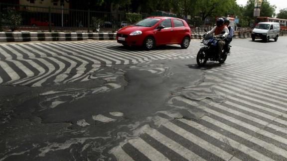 A road melts near Safdarjung Hospital in Delhi on May 24.